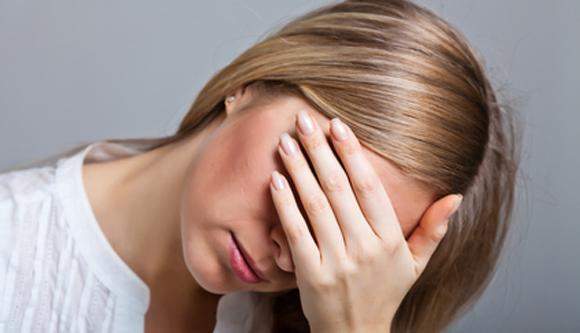 Depressed, sad woman on neutral background